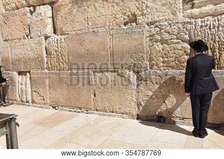Jew In Praying At The Wailing Wall In Jerusalem, Israel.