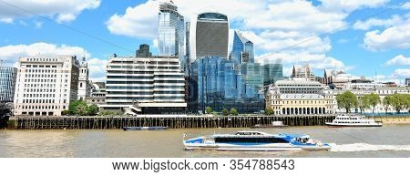 London, Uk; May 1, 2020 - Cityscape Of London, Uk With Boat And High Office Buildings