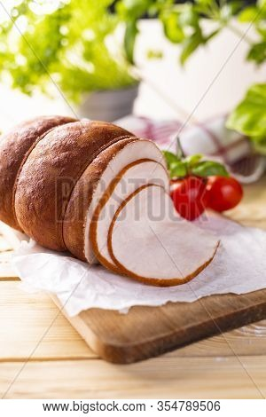 Poultry Cold Cuts On Wooden Cutting Board. Chicken Smoked Cold Cuts.