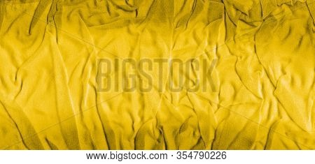Vibrant Yellow Texture Of Binding Crumpled Fabric. Yellow Textile Background With Natural Folds. Clo
