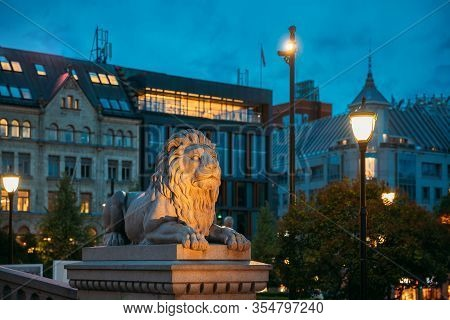 Oslo, Norway. Night View Of Lion Statue Near Storting Building. Parliament Of Norway Building.