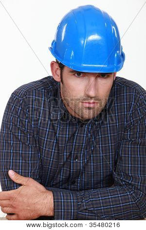 pensive man with a helmet