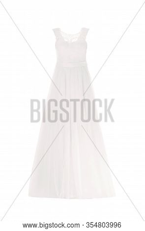 Elegant Wedding Dress On Mannequin Against White Background. Custom Made Clothes