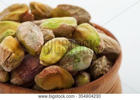 Pistachio Nuts. Many Pistachios Isolated On A White Background.