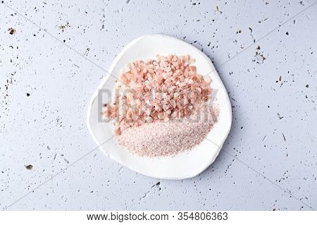 Pink Himalaya Salt on a white ceramic plate. Top view