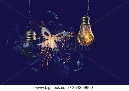 A Firefly Butterfly Flies Out Of A Crashed Incandescent Lamp. Fairytale Picture. Dark Blue Backgroun