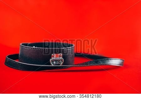 Sex Toys Collar With Leash Isolated On Red Background