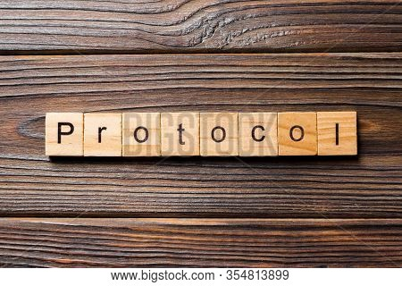 Protocol Word Written On Wood Block. Protocol Text On Wooden Table For Your Desing, Concept
