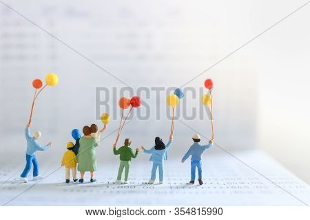 Business, Money, Finance And Family Concept. Group Of Children And Kid Miniature Figure People With