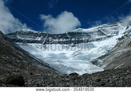 The Mirror Of Karma At The Sacred Mount Kailash On The Background Of Blue Sky And White Clouds, Tibe