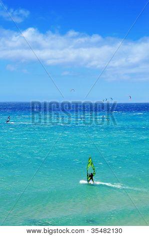 Windsurfers and kitesurfers in Sotavento Beach in Fuerteventura, Canary Islands, Spain
