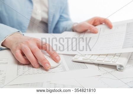 Business woman using computer mouse and keyboard at office