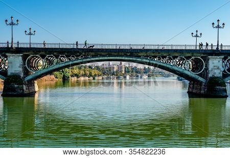 Seville / Spain - December 23 2014: View Of The Puente De Isabel Ii (or Puente De Triana), A Bridge