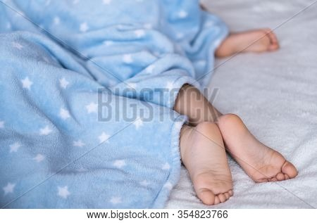 Heels And Toes On Bed. Heels And Feets. Childrens Feet. Barefeet On The Bed. Kids Feet In Bed. Kids