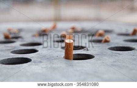 Cigarette butts in a big ashtray
