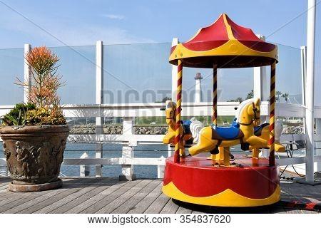 LONG BEACH, CALIFORNIA - 06 MAR 2020: Coin operated carousel ride at Shoreline Village at Rainbow Harbor.