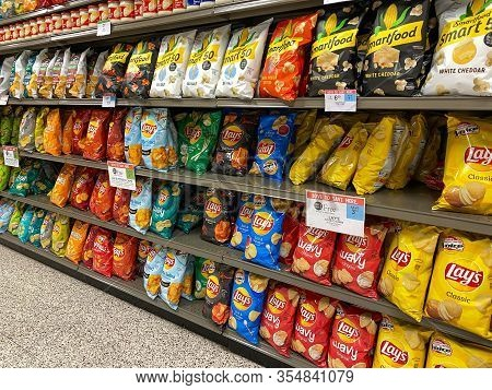 Orlando, Fl/usa-3/7/20: A Display Of Lays Potato Chips On A Display Shelf Of A Publix Grocery Store.