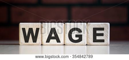 Wage On Wooden Blocks. Wages Rate. Business Concept.
