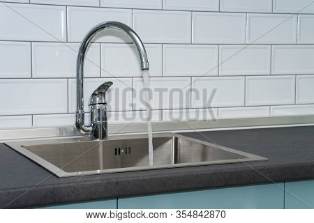 Kitchen Sink And Water Tap In The Kitchen In A Modern Apartment. Domestic Appliances