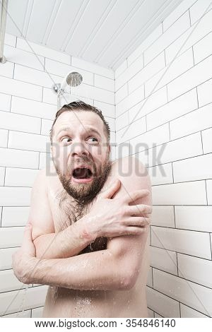 Man With A Stupid Expression On His Face Feels Shocked At Taking A Cold Shower, He Froze And Screams