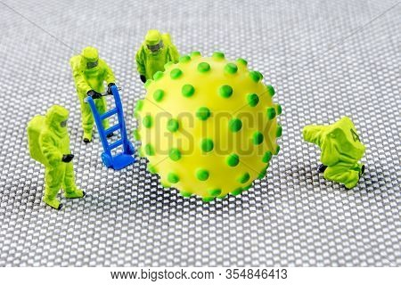 Closeup Of Big Corona Virus With A Team Of Special Medical Forces Miniature Figurines Interfering Du