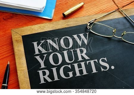 Redundancy Concept. Know Your Rights Sign On The Blackboard.