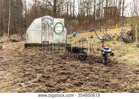 Agricultural Work. Gardening. Spring Preparation Soil For Seeding With Tiller.  Spade, Pitchfork And