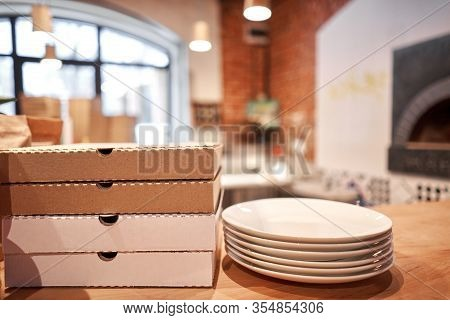 Pizza Delivery Concept. Baked Products In A Cardboard Box Against A Wooden Background. Baked Tasty M