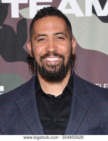 LOS ANGELES - FEB 25:  Neil Brown Jr. arrives for ÔÕSeal TeamÕ Winter Premiere on February 25, 2020 in Hollywood, CA