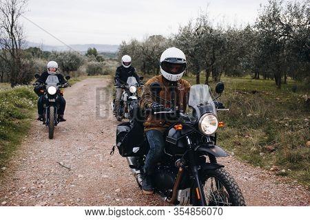Group Of Motorcycle Bikers On Gravel Dirt Road
