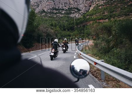 Group Of Motorcycle Bikers On Mountain Road
