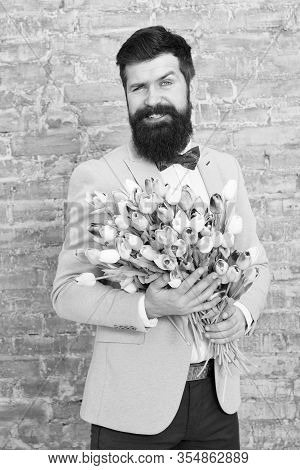 Guide For Modern Man. Romantic Man With Flowers. Romantic Gift. Macho Getting Ready Romantic Date. T