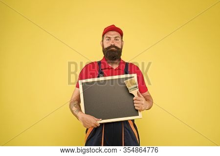 Creative Decorator. Painting Works. Bearded Decorator Laborer Hold Blackboard Copy Space. Repair And