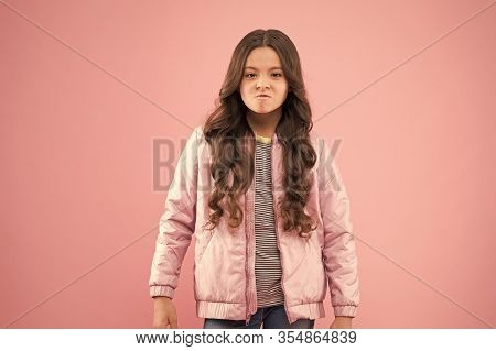 She Doesnt Like Autumn. Small Child Feel Cold In Autumn. With Displeasure Look. Little Girl Wear Fas