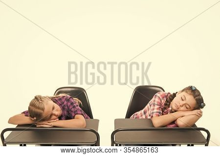 Surviving A Boring Lesson. Cute School Children Sleeping At School Desks. Little Schoolgirls Got Tir