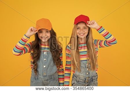 The Hipster Subculture. Happy Little Hipsters Wearing Baseball Caps On Yellow Background. Cute Small