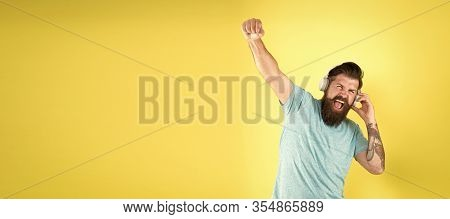 Vocal Singing. Happy Hipster Do Vocal On Song Yellow Background. Bearded Man Enjoy Singing To Vocal