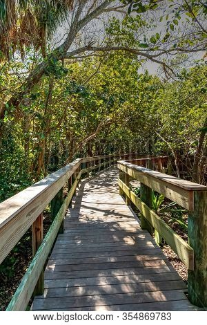 Boardwalk Leading To Sarasota Bay With A Calm, Tranquil Waterfront View In Sarasota, Florida