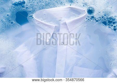 White Shirt Soak In Powder Detergent Water Dissolution, Washing  Cloth. Laundry Concept