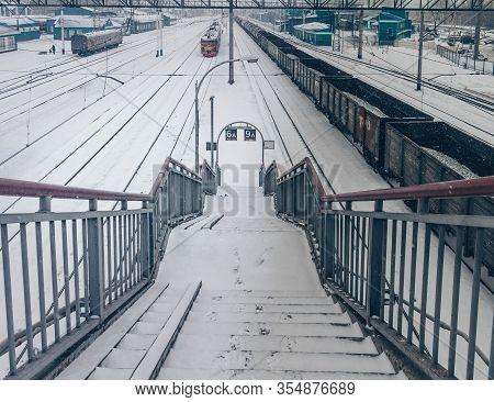 Novokuznetsk, Kemerovo Region, Russia. March 09, 2020. Descent From The Pedestrian Bridge At The Rai