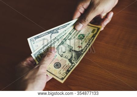 Business Man Give Money Bribe Concept / Person Hands Man Giving Money On Wooden Table Background Pay