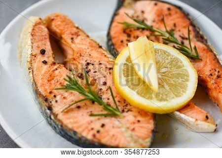 Grilled Salmon Steak With Herbs And Spices Rosemary On Plate Background / Close Up Cooked Salmon Fis