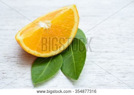 Orange Fruit On Wooden Background / Fresh Orange Slice Half And Orange Leaf Healthy Fruits Concept