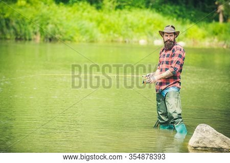 Brutal Hipster Fishing. Male Hobby. Happy Fishermen In Water. Hobby Sport Activity. Hobby And Recrea
