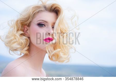 Fashion Haircut. Closeup Blonde Woman Portrait With Blonde Shiny Wavy Hair. Beautiful Model With Cur