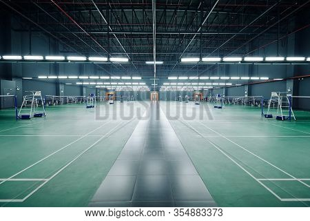 Empty Gymnasium With Courts For Badminton And Tennis Competitions And Training