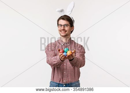 Traditions, Religious Holidays, Celebration Concept. Happy Kind And Cute European Man In Rabbit Ears