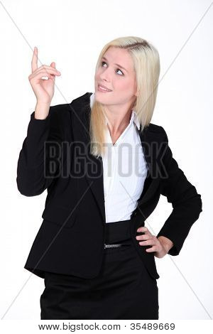 Businesswoman pointing her finger upwards