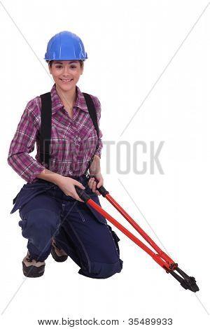 Woman holding bolt cutter