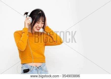 Young Asian Beauty Woman Listening Music With Headphones In Playlist Song Application On Smartphone